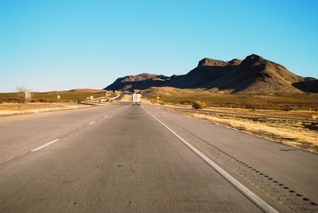 Drive on Interstate 10 eastbound somewhere in western Texas with a desert landscape. photo