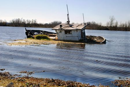 sunken boat: Hurricane Katrina sunk this vessel in a bayou near New Orleans, Louisiana.