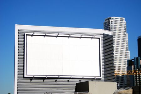 Blank white billboard is available for your corporate advertising in downtown Los Angeles, California. Stock Photo