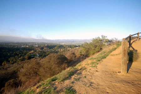 san fernando valley: Smoke rises from a brush fire on the northern end of the San Fernando Valley in Los Angeles county California.