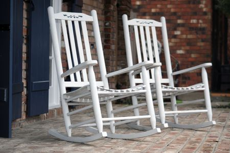 Two rocking chairs resting, southern style, on this front porch. photo