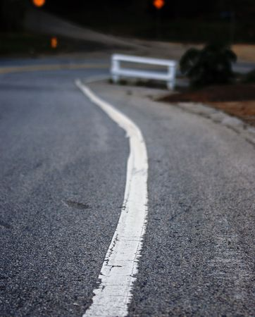 striping: Solid White line traveled on and over for many years.