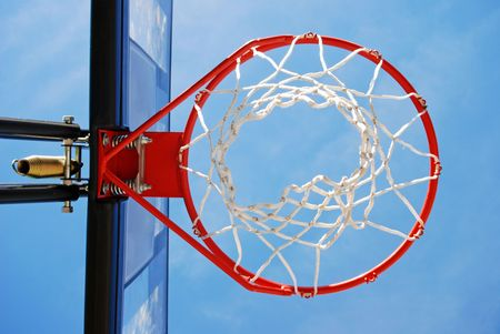 Basketball rim and net placed outside for an outdoors pickup game.