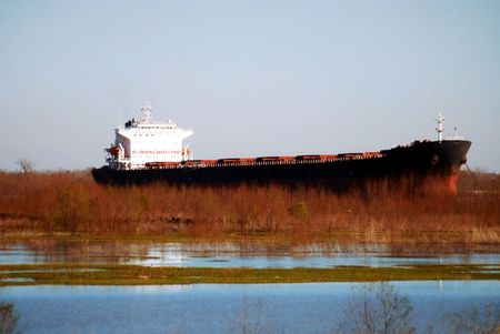 Ship anchored in the Mississippi River channel next to the Bonnet Carrie Spillway near New Orleans, Louisiana.
