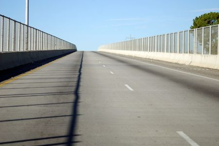 Drive straight forward over the pass on this concrete bridge with chain link fence constructed for safety.