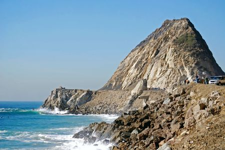 Rock jets up to the sky on the coastline near Los Angeles and Malibu, California in Point Mugu State Park.