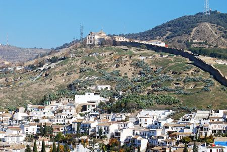 Cave dwellings occupy the hillside as the poor live in these shanties above this neighborhood in Granada, Spain.