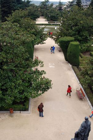 spaniards: People walking through the gardens at the royal palace in Madrid, Spain, Europe.