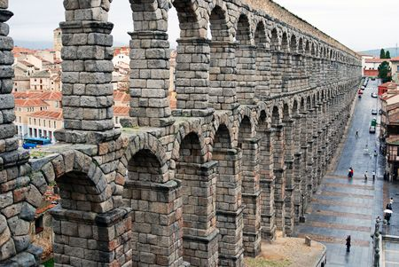 The Roman Aqueduct in Segovia Spain Europe was built to carry water across the city eliminating human inefficiencies and hardship. Stock Photo