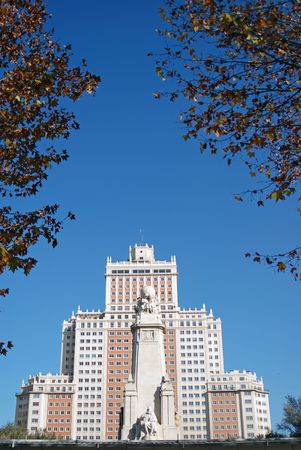 Statue in Madrid, Spain, Europe flanked by resdiential tower and trees.