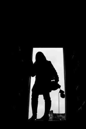 Silhouette of mystery woman in doorway. 免版税图像