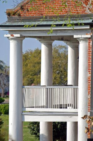 White pillars standing strong on these living quarters in New Orleans, Louisiana post Hurricane Katrina. photo