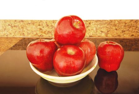 Bowl filled with delicious, juicy red apples.