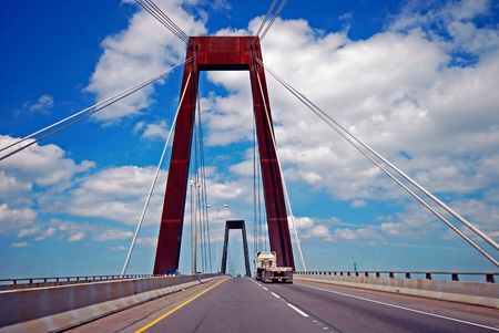 Drive in the fast lane over the Mississippi River suspension bridge in Luling, Louisiana. Stock Photo