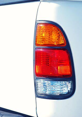 Rear Tail Light to White Passenger Truck.