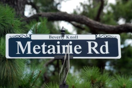 Black and white street sign named Metaire Road on the Beverly Knoll near New Orleans, Louisiana.