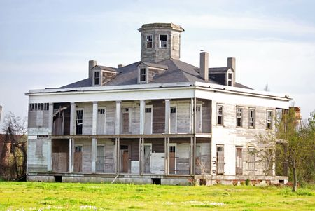 Old house haunted and boarded up on this estate in New Orleans Louisiana.