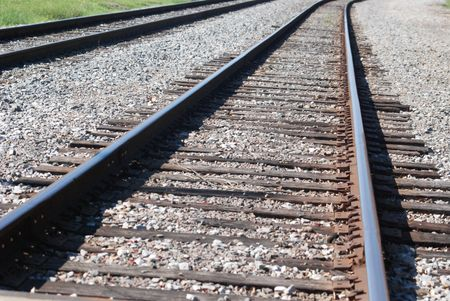 lined up: Steel Train tracks, rail ties, lined up into the horizon.