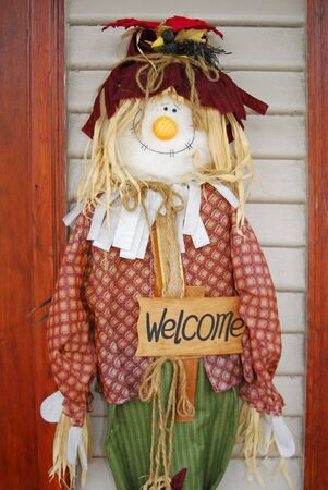 Scarecrow standing in wait with his welcome sign.
