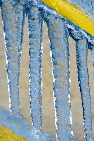 froze: Icicles froze to stair handrailings.