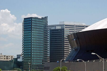 The Superdome definitely makes a statement amongst the office buildings in downtown New Orleans, Louisiana. Stock Photo