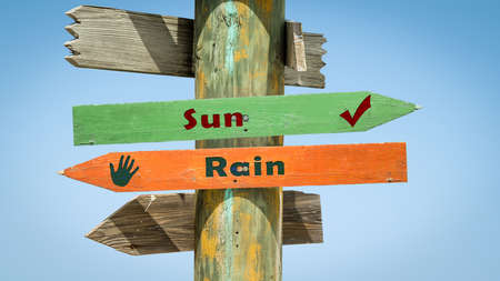 Street Sign Sun versus Rain Stock Photo