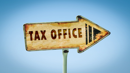Street Sign to Tax Office Stock Photo