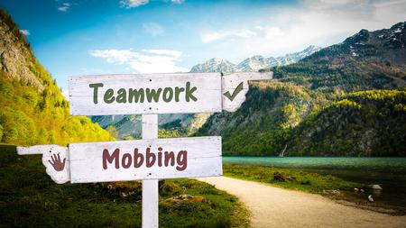 Street Sign Teamwork versus Mobbing