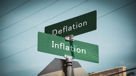 Street Sign the Direction Way to Inflation versus Deflation Stockfoto