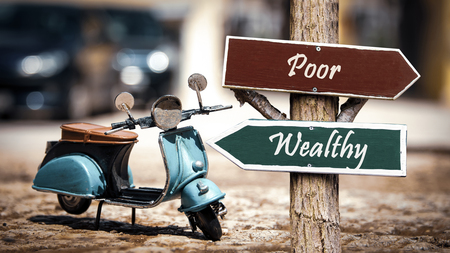 Street Sign the Direction Way to Wealthy versus Poor Stock Photo