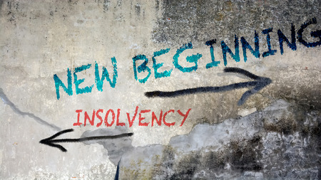 Street Sign Wall Graffiti to BEGINNING versus INSOLVENCY