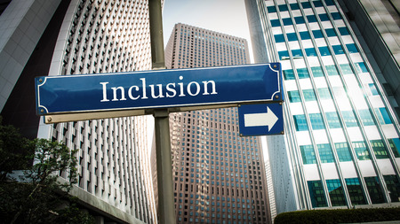 Street Sign the Direction Way to Inclusion Banco de Imagens