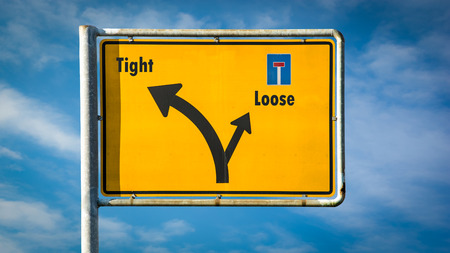 Street Sign the Direction Way to Tight versus Loose Stock Photo