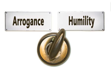Street Sign the Direction Way to Humility versus Arrogance Foto de archivo