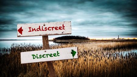 Street Sign the Direction Way to Discreet versus Indiscreet Stok Fotoğraf