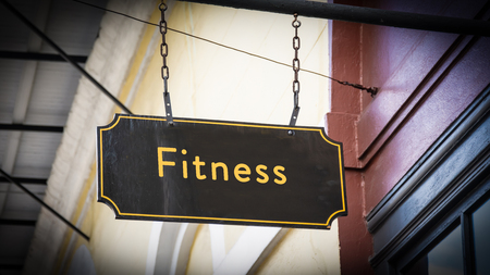 Street Sign the Direction Way to Fitness Stock Photo - 124899599