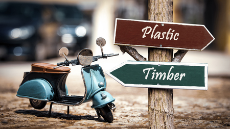 Street Sign the Direction Way to Timber versus Plastic 스톡 콘텐츠