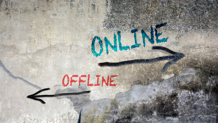 Wall Graffiti the Direction Way to Online versus Offline Stock Photo