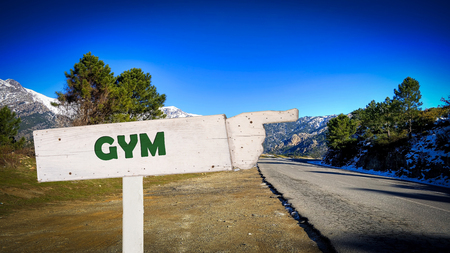 Street Sign the Direction Way to Gym Stock Photo - 124902404