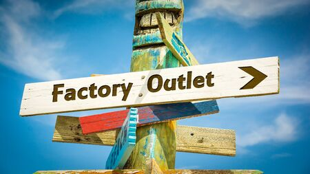 Street Sign the Direction Way to FACTORY OUTLET Stock Photo - 124908410