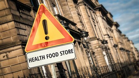 Street Sign the Direction Way to HEALTH FOOD STORE Stock Photo