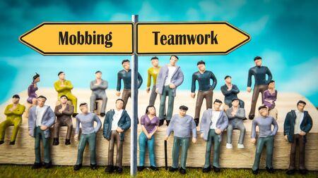 Street Sign the Direction Way to Teamwork versus Mobbing