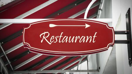 Street Sign the Direction Way to Restaurant Stock Photo