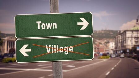 Street Sign the Direction Way to Town versus Village Zdjęcie Seryjne