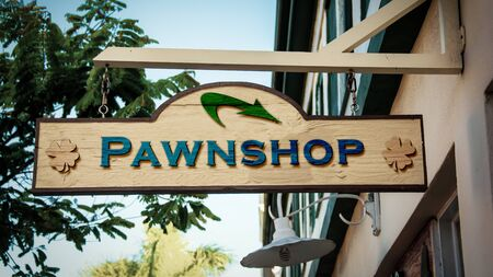 Street Sign the Direction Way to Pawnshop