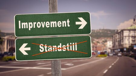 Street Sign the Direction Way to Improvement versus Standstill Stock Photo