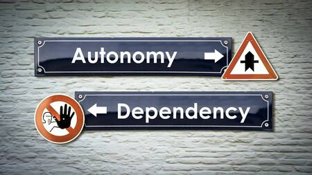 Street Sign the Direction Way to Autonomy versus Dependency 스톡 콘텐츠 - 125287297
