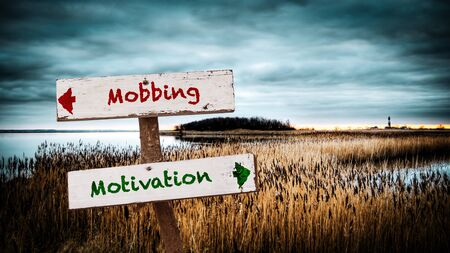 Street Sign the Direction Way to Motivation versus Mobbing Stock Photo