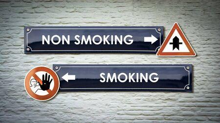 Street Sign the Direction Way to Smoking versus Non Smoking Stock Photo