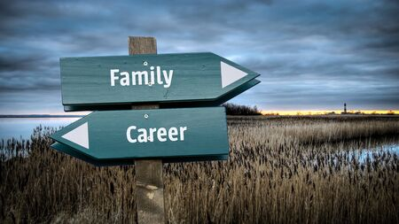 Street Sign the Direction Way to Family versus Career 스톡 콘텐츠
